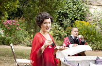 PRIVATE LIVES   by Noel Coward   costumes: Adrian Lillie   director: Nicholas Green ~Pandora Clifford (Amanda), Rodney Matthew (Elyot) ~Oxford Shakespeare Company / Wadham College Gardens, Oxford, Eng...