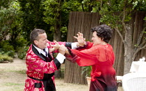 PRIVATE LIVES   by Noel Coward   costumes: Adrian Lillie   director: Nicholas Green ~Rodney Matthew (Elyot), Pandora Clifford (Amanda)~Oxford Shakespeare Company / Wadham College Gardens, Oxford, Engl...