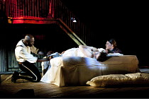 OTHELLO  by Shakespeare  design: Philip Witcomb  lighting: John Tapster  director: Ben Crocker  V/ii - Emilia confronts Othello across unconscious Desdemona - l-r: Christopher Obi (Othello), Emily Pe...