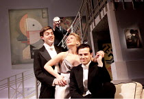 DESIGN FOR LIVING   by Noel Coward   design: Lez Brotherston   lighting: David Hersey   director: Anthony Page ~~l-r: Tom Burke (Otto), Lisa Dillon (Gilda), Andrew Scott (Leo) with (rear) Angus Wright...