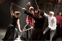 MACBETH   by Shakespeare   director: Grzegorz Bral ~rear centre: Gabriel Gawin (Macbeth)   right: Anna Zubrzycki (Lady Macbeth)   ~Song of the Goat Theatre (Poland) / bite10 / The Pit / Barbican Centr...