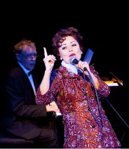 END OF THE RAINBOW   by Peter Quilter   design: William Dudley   lighting: Simon Corder   director: Terry Johnson   Tracie Bennett (Judy Garland) with Hilton McRae (Anthony) in the background at the...