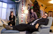 SEASON'S GREETINGS   by Alan Ayckbourn   design: Rae Smith   lighting: Bruno Poet   director: Marianne Elliott ~l-r: Nicola Walker (Rachel), Katherine Parkinson (Pattie), Marc Wootton (Eddie)~Lyttelto...