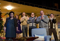 SEASON'S GREETINGS   by Alan Ayckbourn   design: Rae Smith   lighting: Bruno Poet   director: Marianne Elliott ~l-r: Katherine Parkinson (Pattie), Catherine Tate (Belinda), Mark Gatiss (Bernard), Marc...