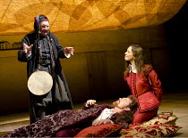 TWELFTH NIGHT   by Shakespeare   design: Anthony Ward   lighting: Peter Mumford   director: Peter Hall ~l-r: David Ryall (Feste), Marton Csokas (Orsino), Rebecca Hall (Viola)~Cottesloe Theatre / Natio...