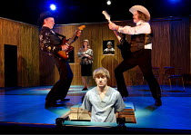 VERNON GOD LITTLE   by DBC Pierre   adapted by Tanya Ronder   set design: Ian MacNeil   costumes: Nicky Gillibrand   director: Rufus Norris    front centre: Joseph Drake (Vernon)   on guitars, l: Nat...
