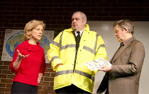 THE HERETIC   by Richard Bean   design: Peter McKintosh   lighting: Paul Pyant   director: Jeremy Herrin   l-r: Juliet Stevenson (Dr Diane Cassell), Adrian Hood (Geoff Tordoff), James Fleet (Professo...