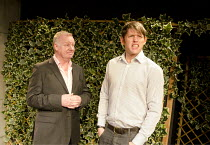 DROWNING ON DRY LAND   by Alan Ayckbourn   design: Georgia Lowe   lighting: Mark Dymock   director: Guy Retallack ~l-r: Les Dennis (Jason Ratcliffe), Christopher Coghill (Charlie Conrad)~Jermyn Street...