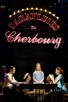 THE UMBRELLAS OF CHERBOURG   music: Michel Legrand   based on the film by Jacques Demy   ~adapted & directed by Emma Rice   lyrics translated by Sheldon Harnick   design: Lez Brotherston   lighting: M...
