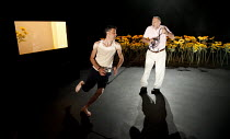 IN THE PENAL COLONY   by Franz Kafka   adapted and directed by Amir Nizar Zuabi   design: Ashraf Hana   lighting: Jackie Shemesh ~l-r: Taher Najib (The Prisoner), Makram Khoury (The Visitor)~Shiberhur...
