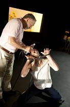 IN THE PENAL COLONY   by Franz Kafka   adapted and directed by Amir Nizar Zuabi   design: Ashraf Hana   lighting: Jackie Shemesh ~l-r: Makram Khoury (The Visitor), Taher Najib (The Prisoner)~Shiberhur...