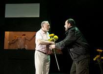 IN THE PENAL COLONY   by Franz Kafka   adapted and directed by Amir Nizar Zuabi   design: Ashraf Hana   lighting: Jackie Shemesh ~l-r: (rear, in window) Taher Najib (The Prisoner), Makram Khoury (The...