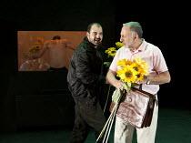 IN THE PENAL COLONY   by Franz Kafka   adapted and directed by Amir Nizar Zuabi   design: Ashraf Hana   lighting: Jackie Shemesh ~l-r: (rear, in window) Taher Najib (The Prisoner), Amer Hiehel (The Ex...