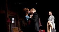 THE HOMECOMING   by Pinter   design: Jon Bausor   lighting: Jon Clark   director: David Farr ~l-r: Aislin McGuckin (Ruth), Jonathan Slinger (Lenny), Justin Salinger (Teddy)~Royal Shakespeare Company (...