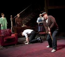 THE HOMECOMING   by Pinter   design: Jon Bausor   lighting: Jon Clark   director: David Farr ~l-r: Aislin McGuckin (Ruth), Jonathan Slinger (Lenny), (crawling away) Richard Riddell (Joey), Des McAleer...