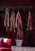 THE HOMECOMING   by Pinter   design: Jon Bausor   lighting: Jon Clark   director: David Farr ~set detail: hook   coat   blood   bucket   abbatoir~Royal Shakespeare Company (RSC) / Swan Theatre, Stratf...
