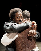 OTHELLO   by Shakespeare   design: Morgan Large   lighting: Lucy Carter   director: Daniel Evans ~~l-r: Clarke Peters (Othello), Dominic West (Iago) ~Crucible Theatre / Sheffield, England   20/09/2011