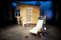 TERRIBLE ADVICE   by Saul Rubinek   design: David Farley   lighting: Paul Anderson   director: Frank Oz   stage   set   flat   empty   yard   garden   fence   exterior   house   palm   tree   lounger...