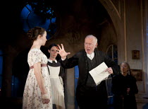 THE VEIL   written & directed by Conor McPherson   design: Rae Smith   lighting: Neil Austin ~l-r: Emily Taaffe (Hannah Lambroke), (rear) Caoilfhionn Dunne (Clare Wallace), Jim Norton (The Reverend Be...