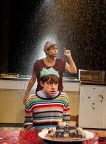 THE KITCHEN SINK   by Tom Wells   design: Ben Stones   lighting: Oliver Fenwick   director: Tamara Harvey   Ryan Sampson (Billy), Lisa Palfrey (Kath) in front of shattered tap Bush Theatre, London W...
