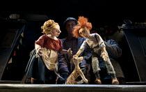 A VERY OLD MAN WITH ENORMOUS WINGS   by Anna Maria Murphy   puppetry director: Sarah Wright   design: Lyndie Wright   lighting: Malcolm Rippeth   director: Mike Shepherd ~l-r: Mother, Dog, Father~in a...
