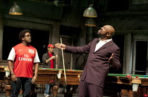 THE COMEDY OF ERRORS   by Shakespeare   design: Bunny Christie   lighting: Paule Constable   director: Dominic Cooke ~l-r: Lucian Msamati (Dromio of Syracuse), Lenny Henry (Antipholus of Syracuse)~Oli...