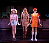 COMPANY   music & lyrics: Stephen Sondheim   design: Christopher Oram   lighting: Neil Austin   director: Jonathan Munby ~l-r: Rosalie Craig (Marta), Kelly Price (Kathy), Lucy Montgomery (April)~Cruci...