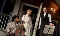 THE LADYKILLERS   in a new stage adaptation by Graham Linehan   design: Michael Taylor   lighting: James Farncombe   director: Sean Foley   enter Mrs Wilberforce - l-r: Clive Rowe (One-Round), Marcia...