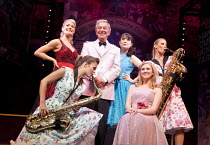 DREAMBOATS AND PETTICOATS   book: Laurence Marks & Maurice Gran   design: Sean Cavanagh   lighting: Mark Howett   director: Bob Tomson ~centre: Des O'Connor (Older Bobby/Phil)~Playhouse Theatre, Londo...