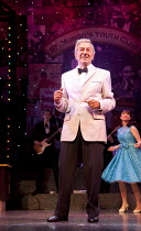 DREAMBOATS AND PETTICOATS   book: Laurence Marks & Maurice Gran   design: Sean Cavanagh   lighting: Mark Howett   director: Bob Tomson ~Des O'Connor (Older Bobby/Phil)~Playhouse Theatre, London WC2...