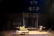SHE STOOPS TO CONQUER   by Oliver Goldsmith   design: Mark Thompson   lighting: Neil Austin   director: Jamie Lloyd ~~stage   set   empty   fireplace   candle   furniture~Olivier Theatre / National Th...
