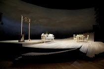 THE LADY FROM THE SEA   by Ibsen   set design: Simon Higlett   costumes: Mark Bouman   lighting: Malcolm Rippeth   director: Stephen Unwin ~stage   set   empty   table   chair   wood~Rose Theatre King...