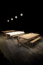 FAREWELL TO THE THEATRE   by Richard Nelson   design: Hildegard Bechtler   lighting: Rick Fisher   director: Roger Michell ~stage   set   empty   table   bench   light~Hampstead Theatre (HT), London N...