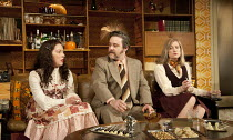 ABIGAIL'S PARTY   by Mike Leigh   design: Mike Britton   lighting: Howard Harrison   director: Lindsay Posner ~l-r: Nathalie Casey (Angela), Andy Nyman (Laurence), Susannah Harker (Susan)~Menier Choco...