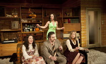 ABIGAIL'S PARTY   by Mike Leigh   design: Mike Britton   lighting: Howard Harrison   director: Lindsay Posner ~front, l-r: Nathalie Casey (Angela), Andy Nyman (Laurence), Susannah Harker (Susan)   rea...