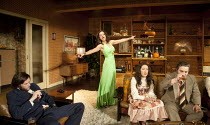 ABIGAIL'S PARTY   by Mike Leigh   design: Mike Britton   lighting: Howard Harrison   director: Lindsay Posner ~l-r: Joe Absolom (Tony), Jill Halfpenny (Beverley), Nathalie Casey (Angela), Andy Nyman (...