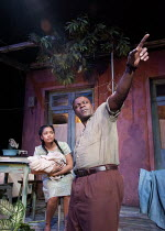 pointing at the moon: Tahirah Sharif (Esther), Danny Sapani (Ephraim) in MOON ON A RAINBOW SHAWL by Errol John at the Cottesloe Theatre, National Theatre (NT), London SE1  14/03/2012  design: Soutra...