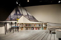 THE GIRL IN THE YELLOW DRESS   by Craig Higginson   design: James Perkins   lighting: Ben Ormerod   director: Tim Roseman ~stage   set   empty   books   Paris   Eiffel Tower~Salisbury Playhouse produc...