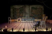 ASSASSINS   music & lyrics: Stephen Sondheim   book: John Weidman   set design: David Esler   costumes: Gemma Veitch   lighting: Sebastian Petit   director: Ray Rackham   stage   set   empty   flag...