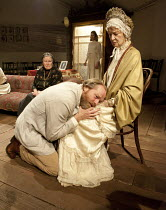 UNCLE VANYA   by Chekhov   in a new version by Mike Poulton   design: William Dudley   lighting: Richard Howell   director: Lucy Bailey ~front, l-r: Marlene Sidaway (Marina), Iain Glen (Vanya), Caroli...