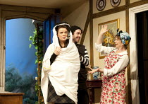 NOISES OFF   by Michael Frayn   design: Peter McKintosh   lighting: Paul Pyant   director: Lindsay Posner ~l-r:  Alice Bailey Johnson (Poppy Norton-Taylor), Paul Ready (Tim Allgood), Celia Imrie (Dott...