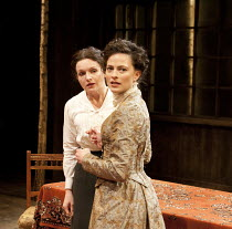 UNCLE VANYA   by Chekhov   translated by Michael Frayn   design: Peter McKintosh   lighting: Chahine Yavroyan   director: Jeremy Herrin ~l-r: Dervla Kirwan (Sonya), Lara Pulver (Yelena)~Minerva Theatr...