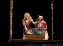 THE COMEDY OF ERRORS   by Shakespeare   design: Jon Bausor   lighting: Jon Clark   director: Amir Nizar Zuabi ~IV/i - l-r: Kirsty Bushell (Adriana), Emily Taaffe (Luciana)~part of 'What Country Friend...