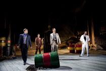 THE COMEDY OF ERRORS   by Shakespeare   design: Jon Bausor   lighting: Jon Clark   director: Amir Nizar Zuabi ~III/i - l-r: Sargon Yelda (Angelo), Ankur Bahl (Messenger), Stephen Hagan (Antipholus of...