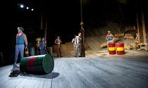 THE COMEDY OF ERRORS   by Shakespeare   design: Jon Bausor   lighting: Jon Clark   director: Amir Nizar Zuabi ~III/i - l-r: Felix Hayes (Dromio of Ephesus), Sargon Yelda (Angelo), Ankur Bahl (Messenge...
