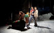 THE COMEDY OF ERRORS   by Shakespeare   design: Jon Bausor   lighting: Jon Clark   director: Amir Nizar Zuabi ~IV/iii: Amie Burns Walker (Courtesan), Bruce MacKinnon (Dromio of Syracuse), Jonathan McG...
