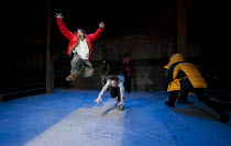 THE CONQUEST OF THE SOUTH POLE   by Manfred Karge   design: Hayden Griffin   lighting: Sherry Coenen   director: Stephen Unwin   leaping, l-r: Mark Field (Buscher), Chris Ashby (Frankieboy)  Arcola...