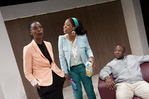 BELONG   by Bola Agbaje   design: Ben Stones   lighting: Malcolm Rippeth   director: Indhu Rubasingham ~l-r: Noma Dumezweni (Rita), Lucian Msamati (Kayode), Jocelyn Jee Esien (Fola)~Tiata Fahodzi / Je...
