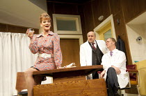 WHAT THE BUTLER SAW   by Joe Orton   design: Alice Power   lighting: Johanna Town   director: Sean Foley   l-r: Samantha Bond (Mrs Prentice), Omid Djalili (Dr Rance), Tim McInnerny (Dr Prentice) Vau...