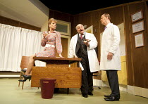 WHAT THE BUTLER SAW   by Joe Orton   design: Alice Power   lighting: Johanna Town   director: Sean Foley ~l-r: Samantha Bond (Mrs Prentice), Omid Djalili (Dr Rance), Tim McInnerny (Dr Prentice)~Vaudev...